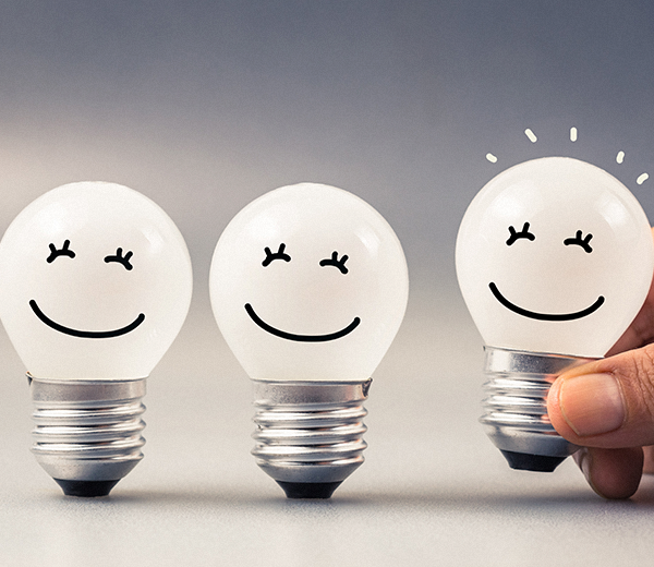 lightbulbs with smiling faces - OCEASOFT